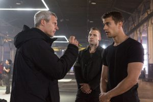 Director NEIL BURGER, JAI COURTNEY and THEO JAMES on the set of DIVERGENT